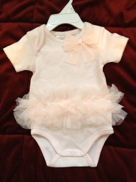 Baby Richards' outfit for her first official outing at Taryn's wedding this September.