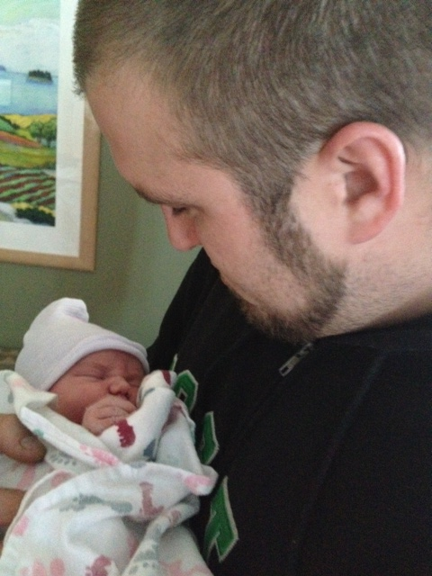 Dan with baby Charlotte...already a pro
