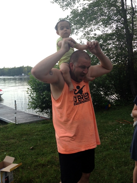 Ryder enjoying a piggy back ride from uncle Dan