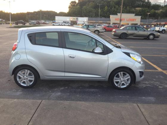 Chevy Spark (I tried to find a picture of an older Chevy Spark for better comedic effect, but none exist. Probably because Chevy Sparks don't last past 30,000 miles.