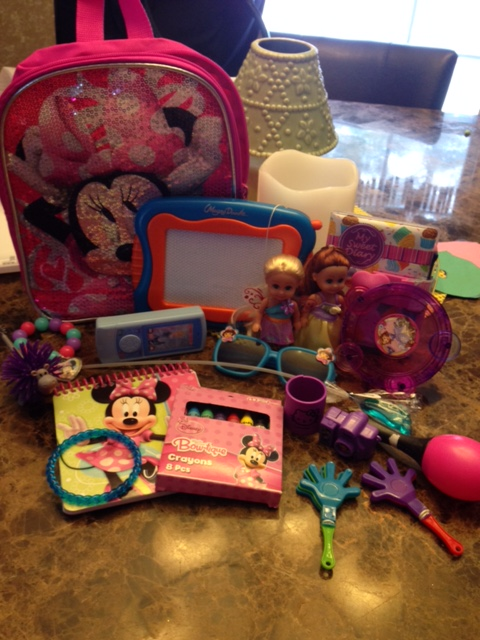 "A backpack full of ""sensory toys"" that Melissa purchased and packed for Mia to help her on our flight to Florida on our family vacation."